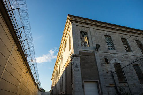 Sun shines on a building inside the prison walls