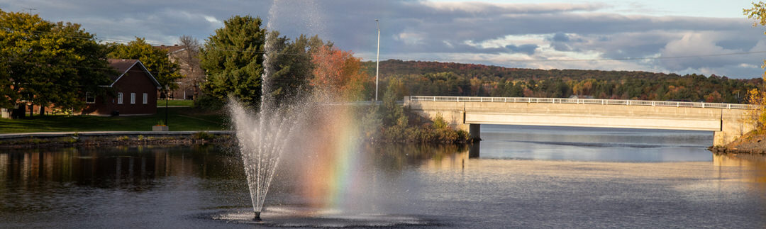 A rainbow created by the cascade of water from the Blind River fountain