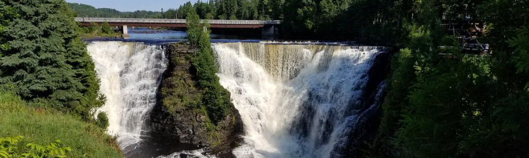 View facing a powerful waterfall crashing over rocks