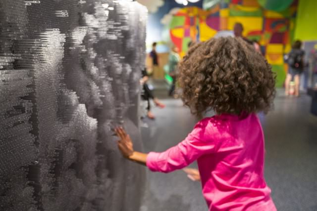 A girl interacting with an exhibit