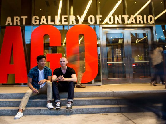 Two men sitting in front of the AGO