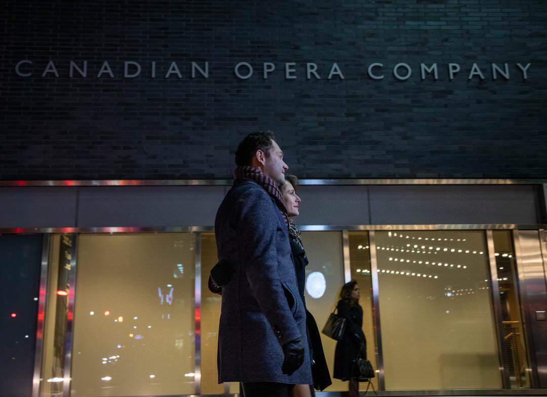 A couple walking outside the Four Seasons Centre