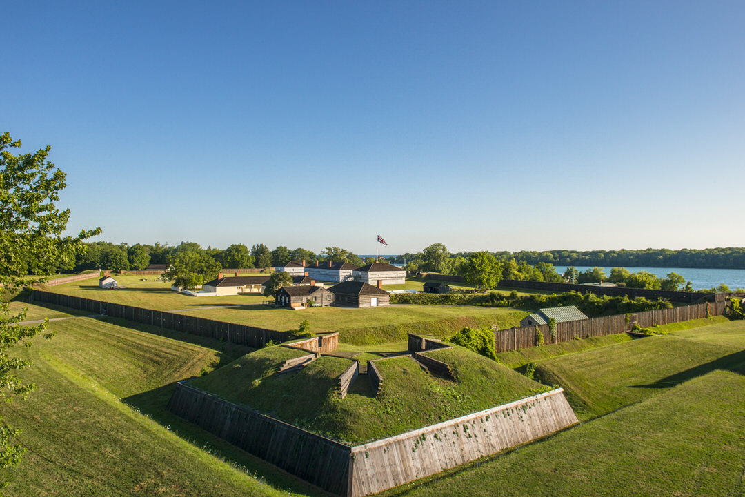 Northfacing view of lawn and buildings of Fort George with Niagara River beyond