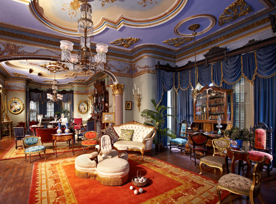 Drawing rooms of historic mansion with vintage furniture and draperies and chandeliers