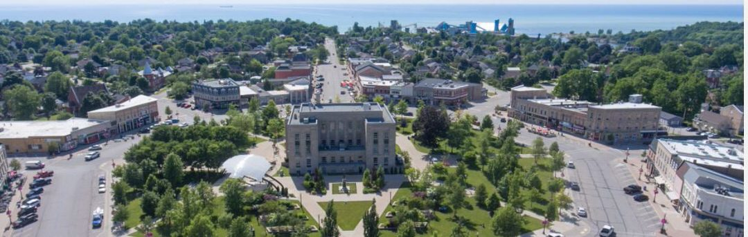Goderich Square in the middle and streets on either side with trees all around
