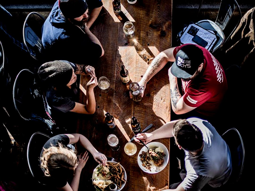 People around a table enjoying a meal
