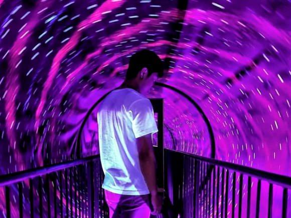 Man in a bright tunnel