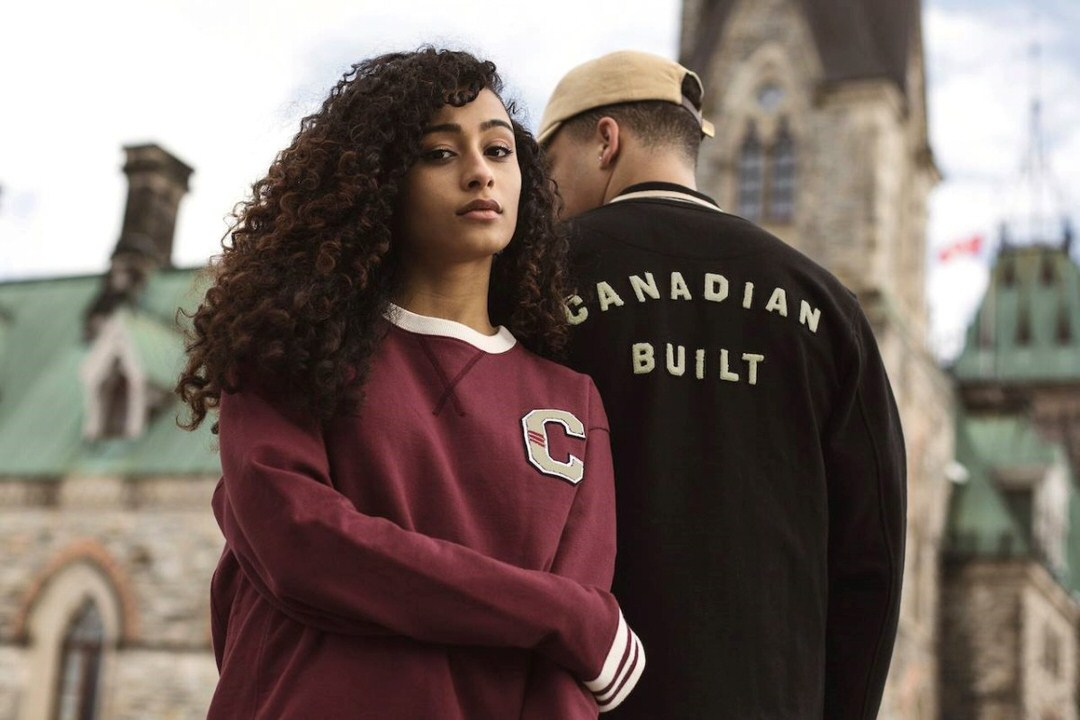 A woman and a man in front of a building