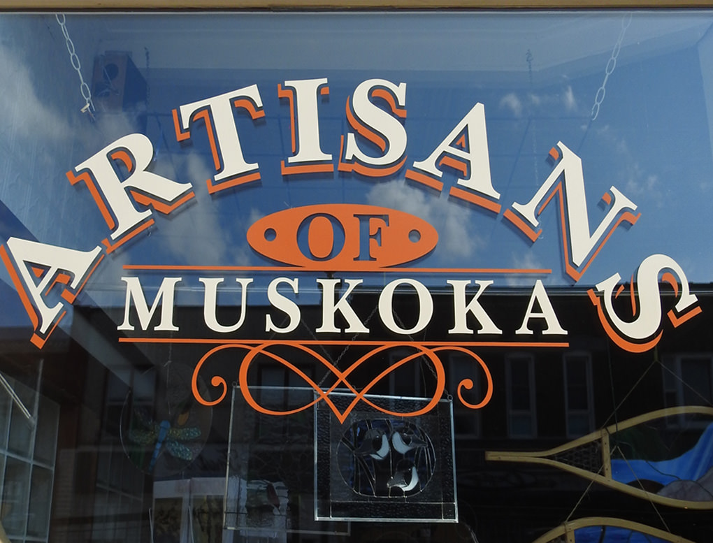 The sign on a shop window for Artisans of Muskoka