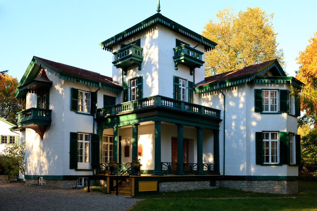 Exterior of historic white and green home
