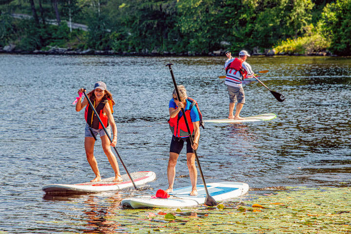 Three people enjoying time on the water on their paddle boards