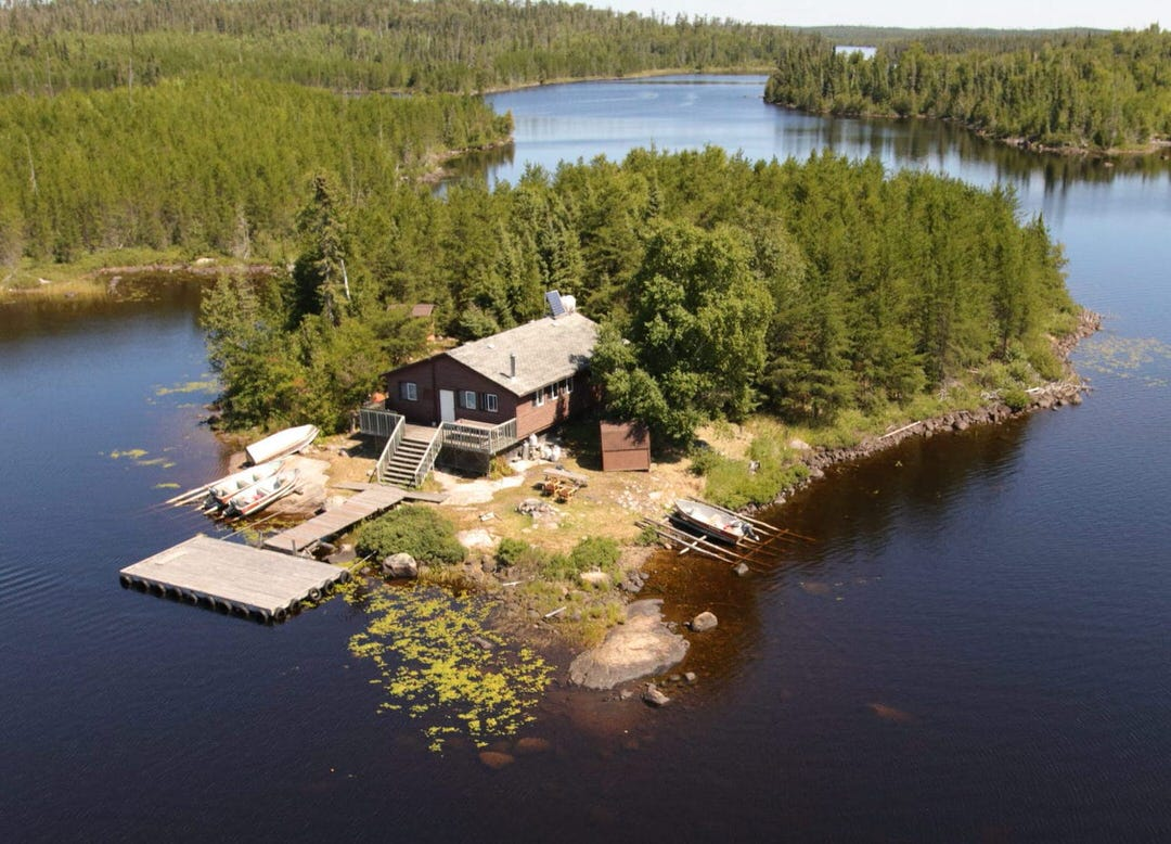 An Aerial perspective of a house on an island