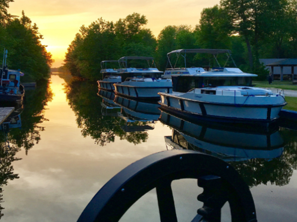 Sunset over boats moored along the Ridea Canal