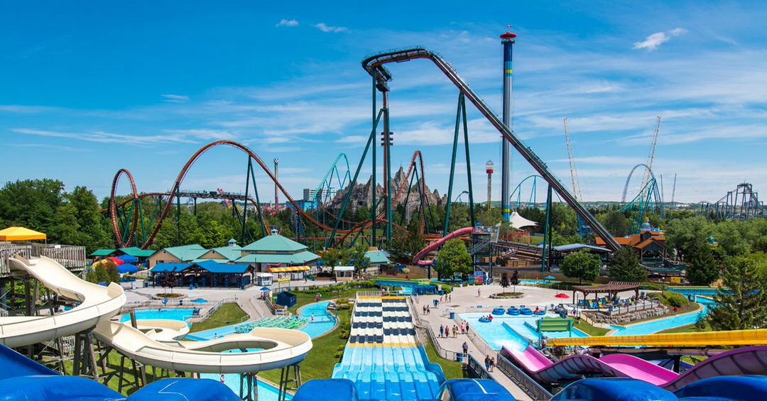 An amusement park filled with water slides, roller coasters and free fall rides.
