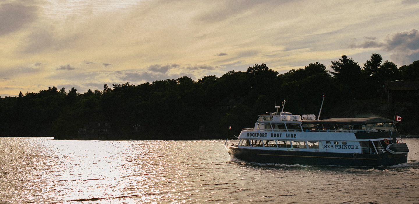 A sightseeing passenger ship cruises in the 1000 Islands