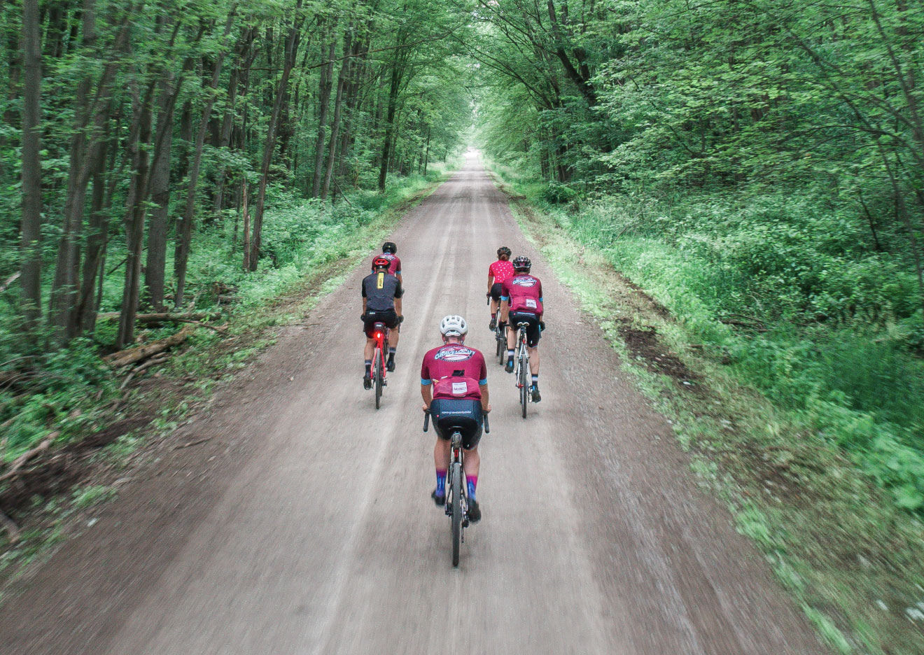 Cyclists riding on a very long path