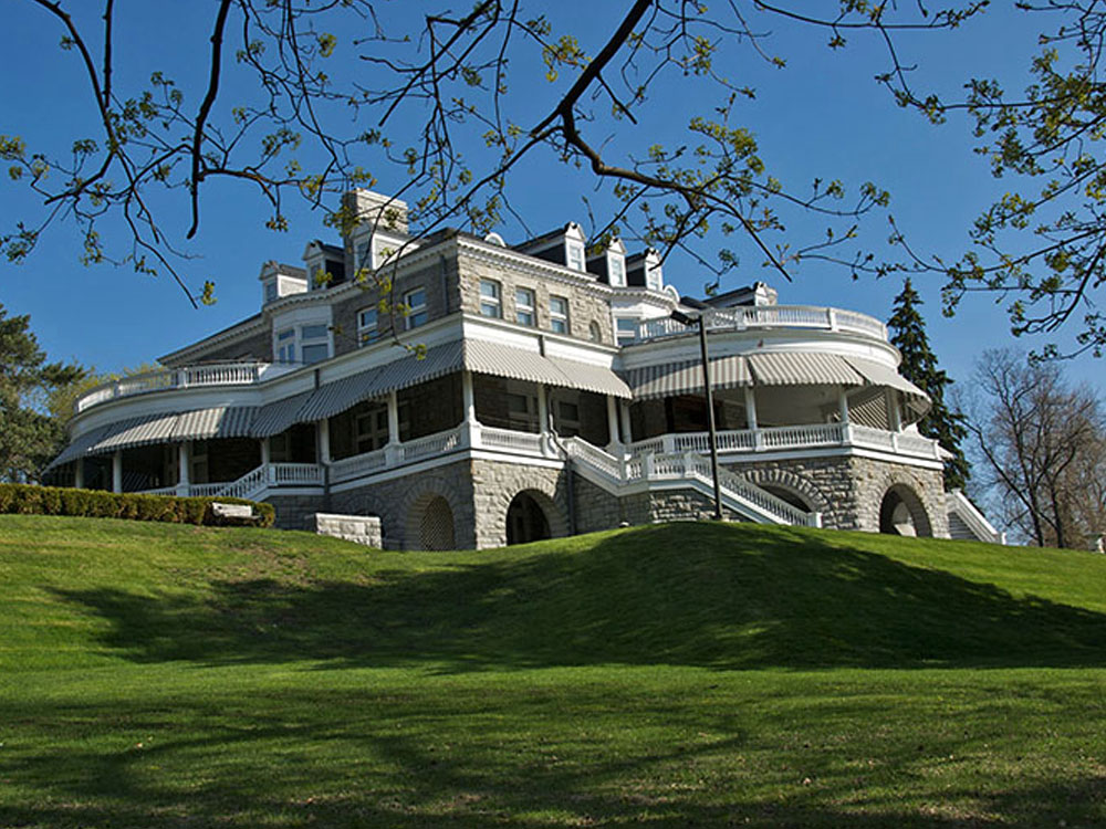 A stunning white mansion on a hill