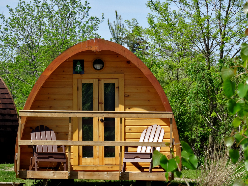 A dome roofed tiny wooden glamping cabin