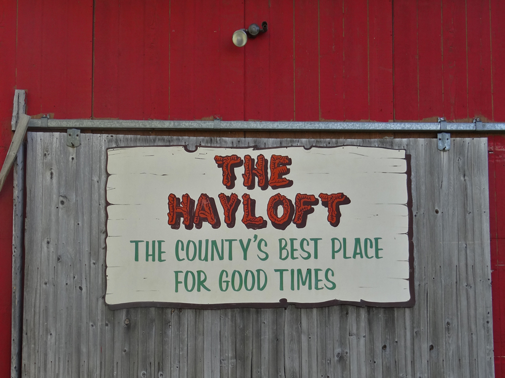 Vintage sign on the side of a rustic barn