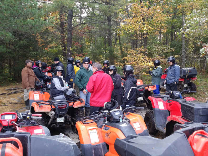 A group of ATV riders get ready for a forest ride