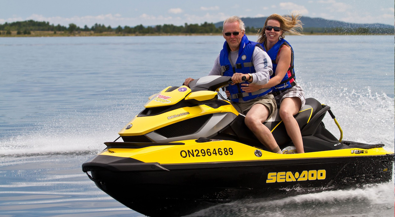 A man and woman ride a Sea-Doo