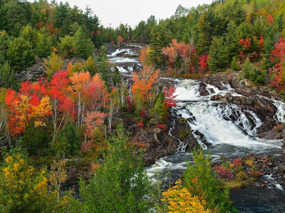 Gorgeous fall colours surround a waterfalls