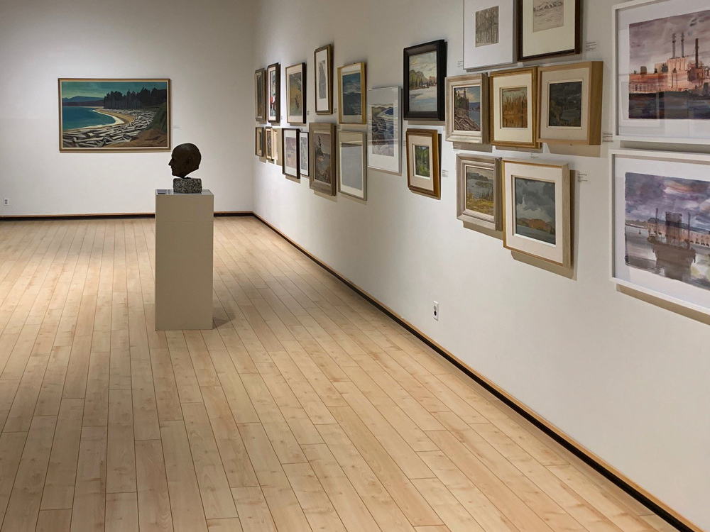 A viewing wall of art at the Algoma Art Gallery