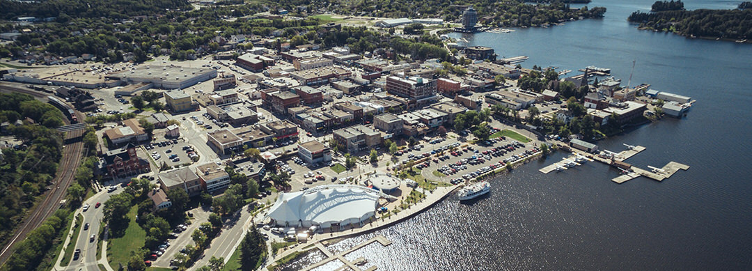 Aerial view of Kenora, the Whitecap Pavillion and docks at the harbourfront