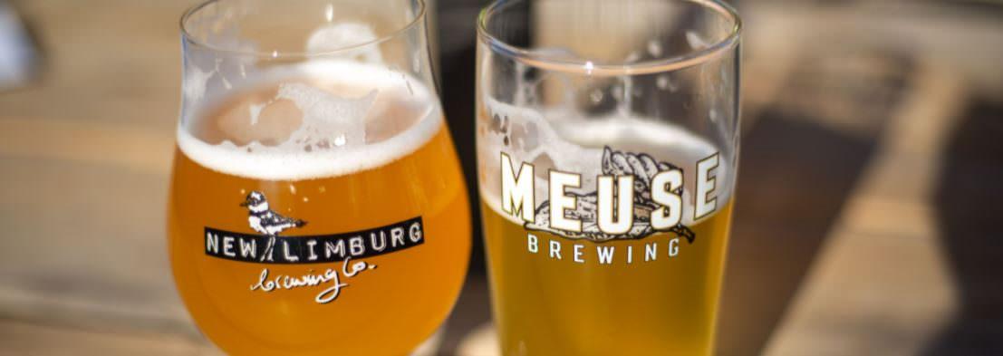 Two glasses of draft Limburg beer