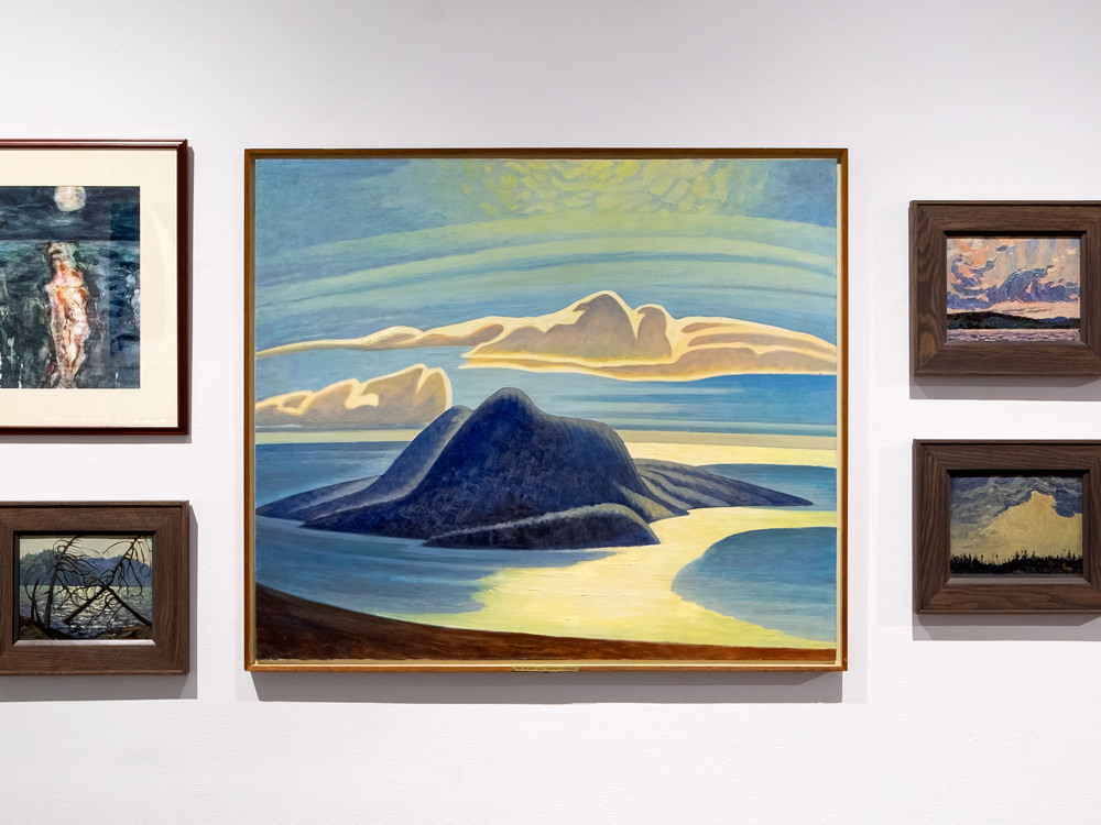 Paintings handing on a gallery wall