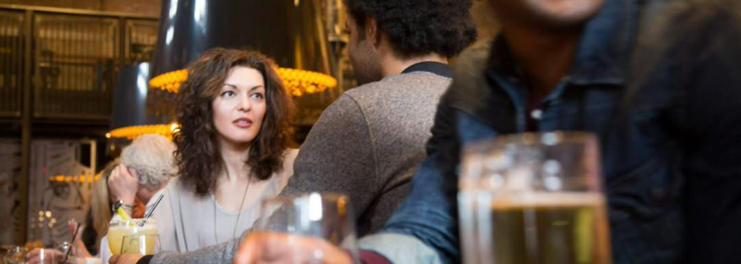 Woman having dinner with a man in a restaurant.