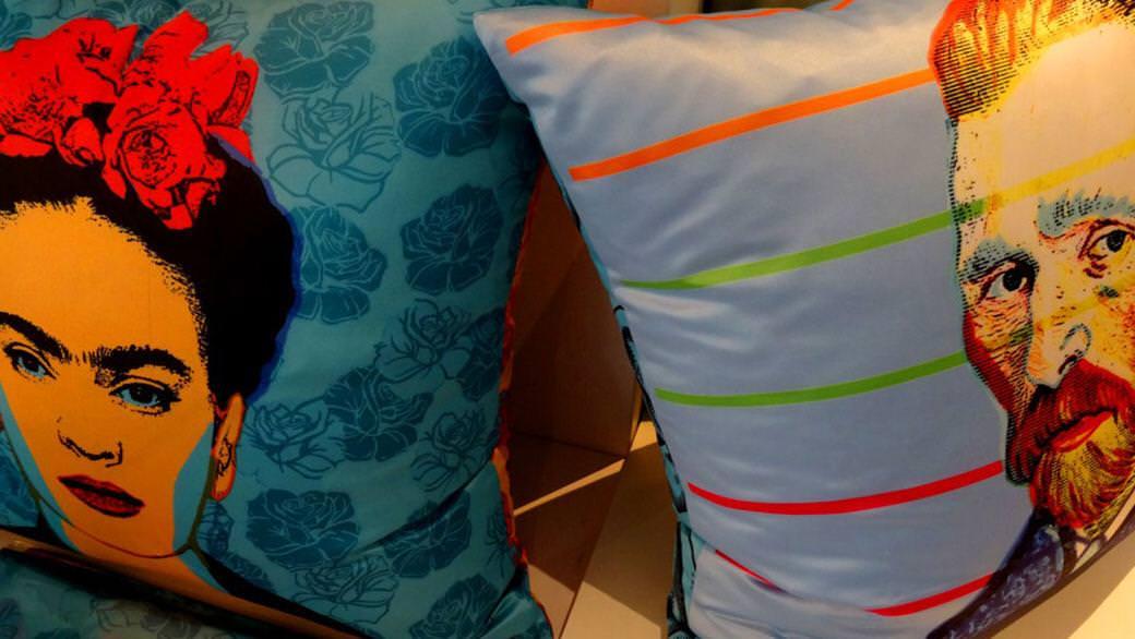 Frida Kahlo and Vincent Van Gogh adorn blue throw pillows