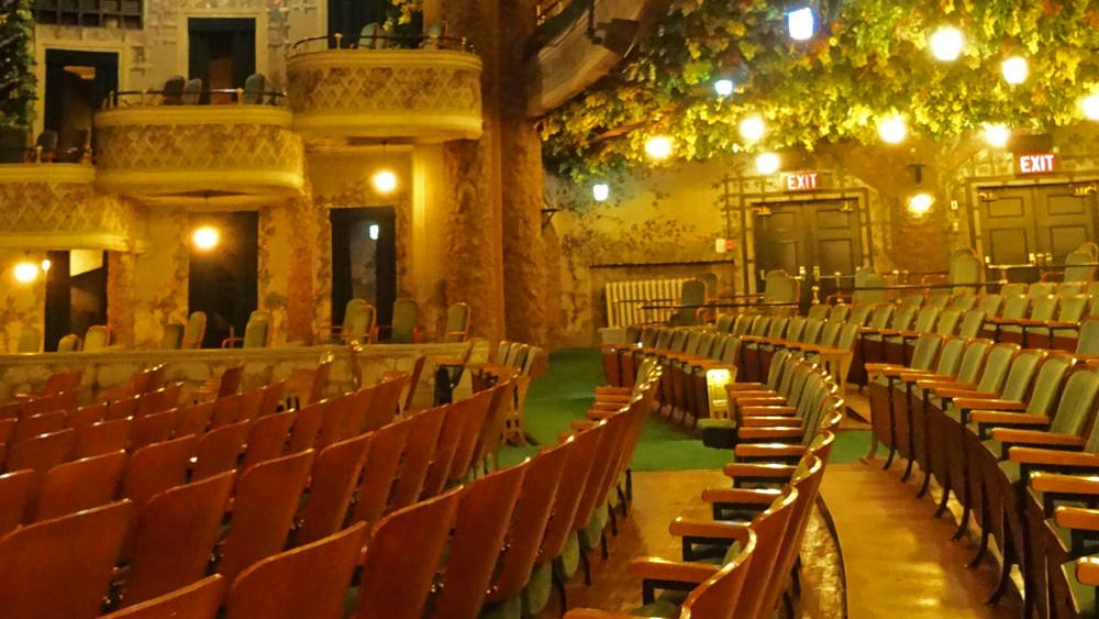 Hand painted flowers and vines and romantic lighting set the mood in the Winter Garden Theatre