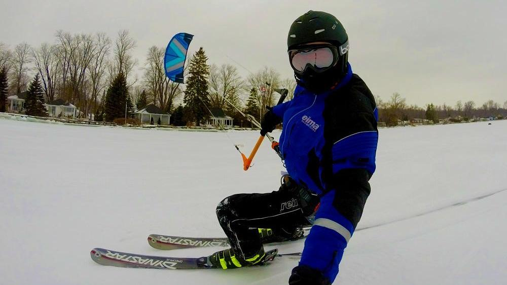 A person snowkiting on a frozen lake