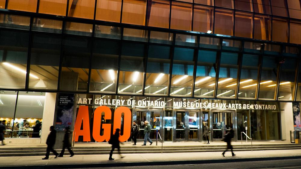 People walking on the sidewalk in front of the Art Gallery of Ontario
