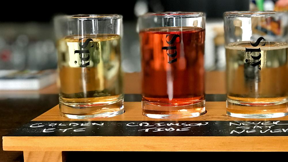 A flight of three different flavours of cider