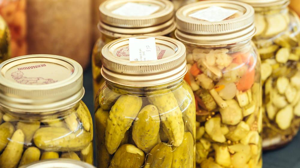 A row of pickled and preserved vegetables