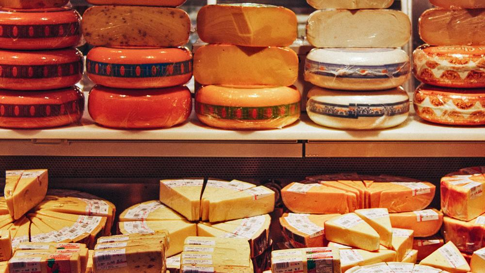 A full display of different kinds of cheese