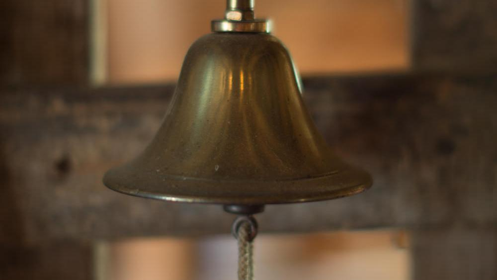 An old fashioned bell in the doorway of a shop
