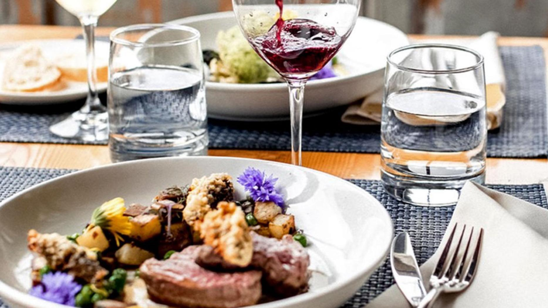A plate of food and wine glasses