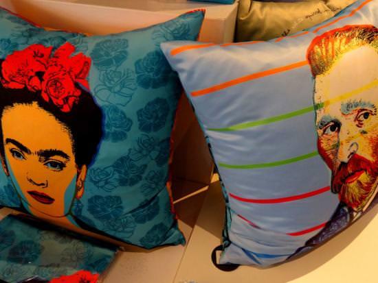 Frida Kahlo and Vincent Van Gogh adorn blue throw pillows.