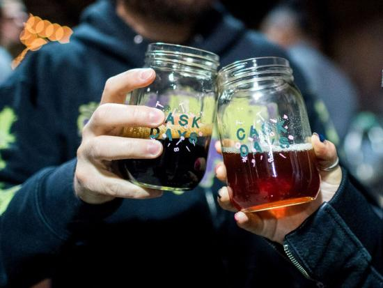 """Two glasses adorned with """"cask days"""" are raised in a toast"""
