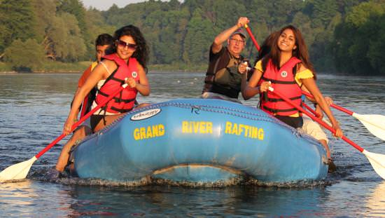 A group of people rafting down a scenic river
