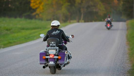 Two motorcyclists riding on an open road