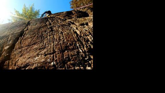 Man rock climbing a steep cliff