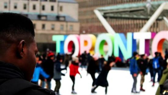 People ice skating downtown in Toronto