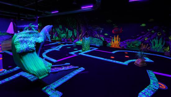 Glow-in-the-dark mini putt course