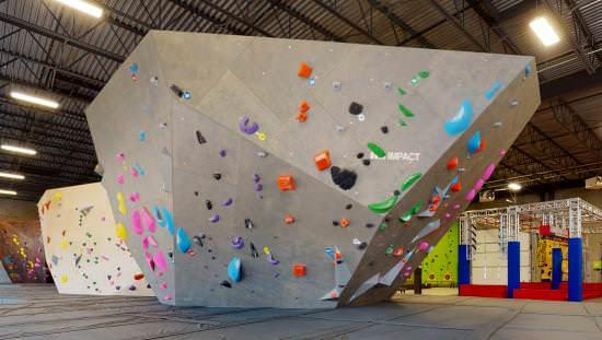Mur d'escalade gris avec poignées colorées
