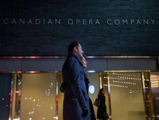 A couple walk past the Canadian Opera Company
