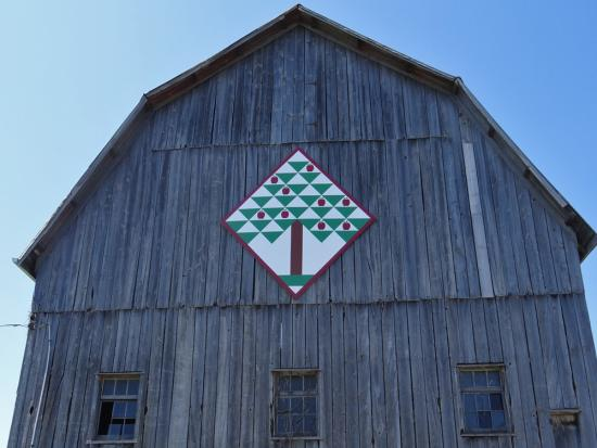 Folk art adorns the front of an old barn